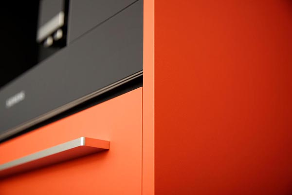 Orange lacquered kitchen cabinets