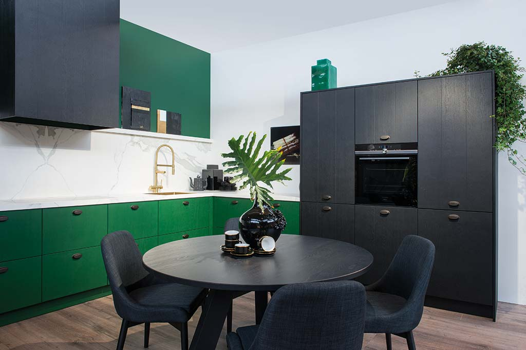Country-style green and black kitchen