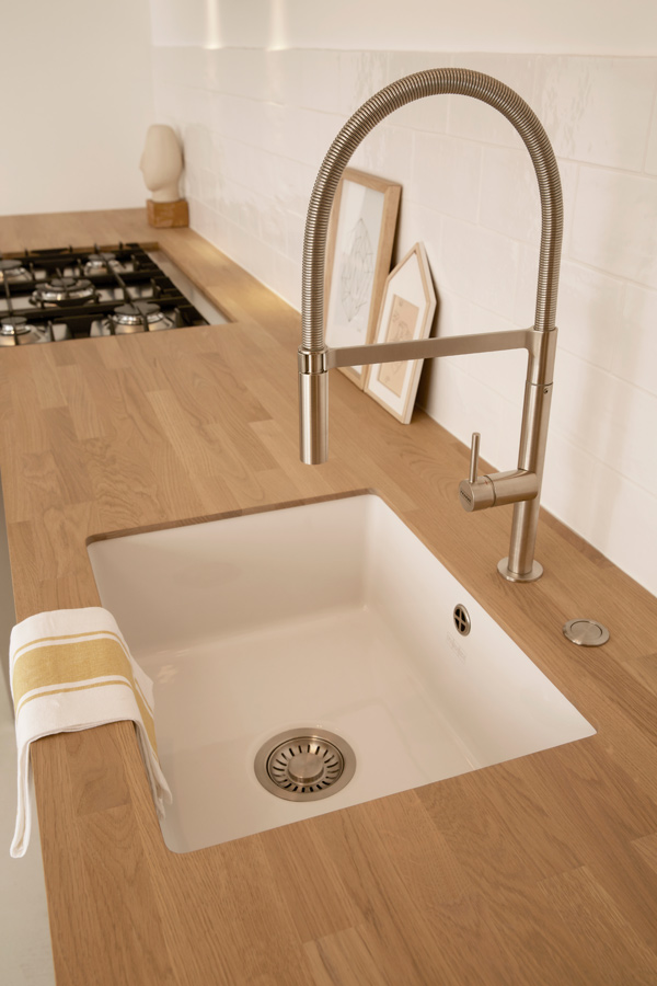 white sink wooden worktop
